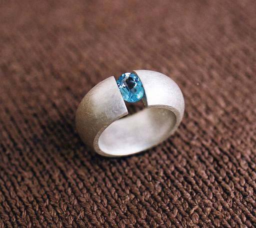 Topaz tension ring